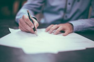 signing closing documents True Concept Title